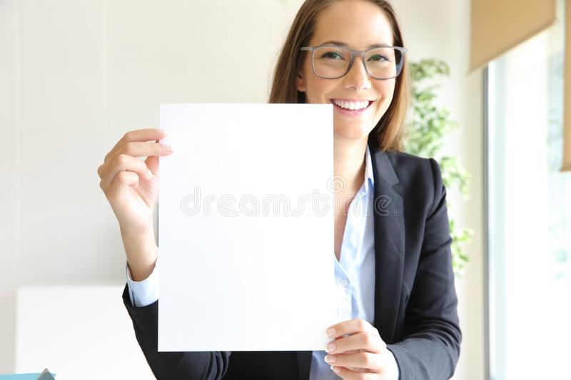 Happy businesswoman showing blank contract at office royalty free stock images