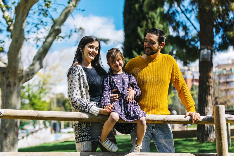 Front view of a happy family in the park. Father mother and son together in nature looking at the camera royalty free stock images