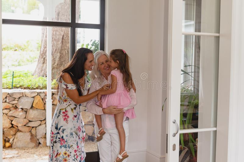Multi-generation family standing together near door in a comfortable home royalty free stock photo