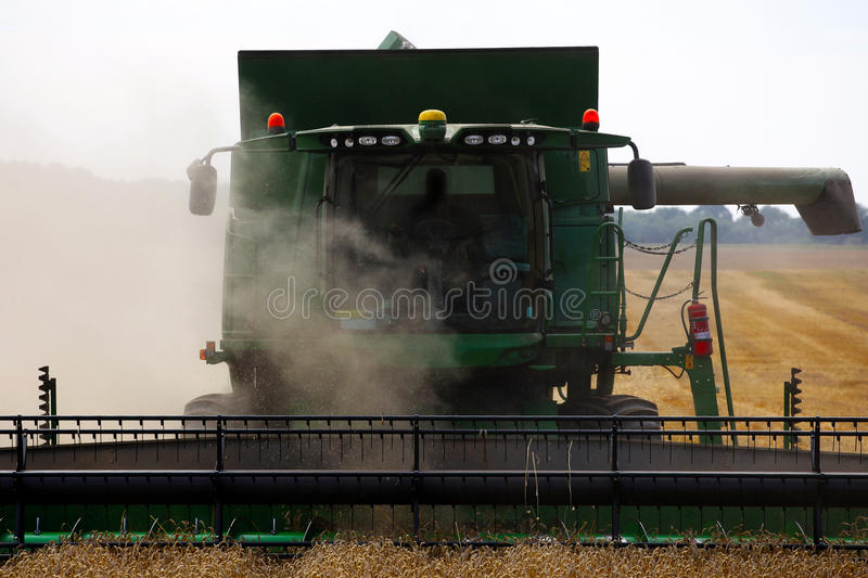 Front view of harvester in action. Harvester in action front view stock photo
