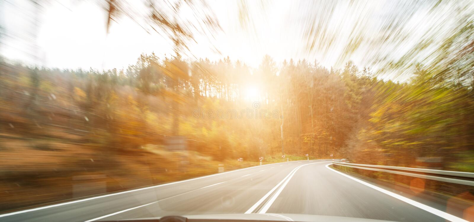 Front view of the highway road passing the country side inside the fast car long exposure shoot royalty free stock photos