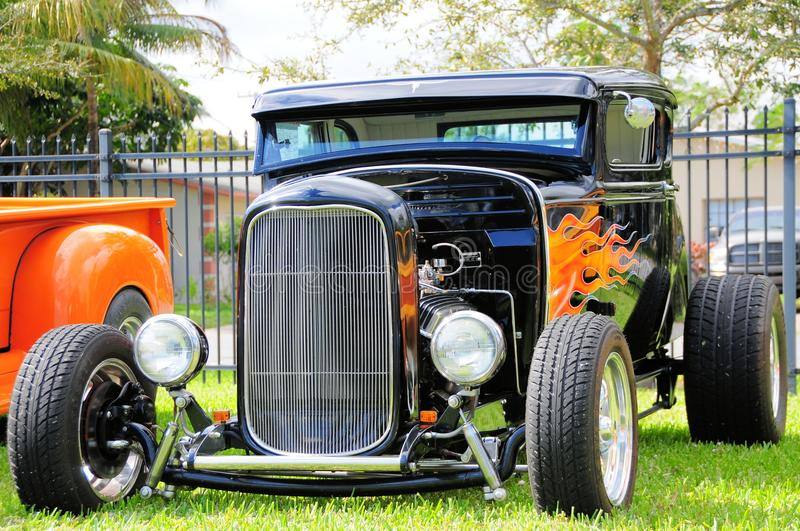 Front view of hot rod roadster car. Front view of an old black car with flames parked in a park in south Florida stock photo