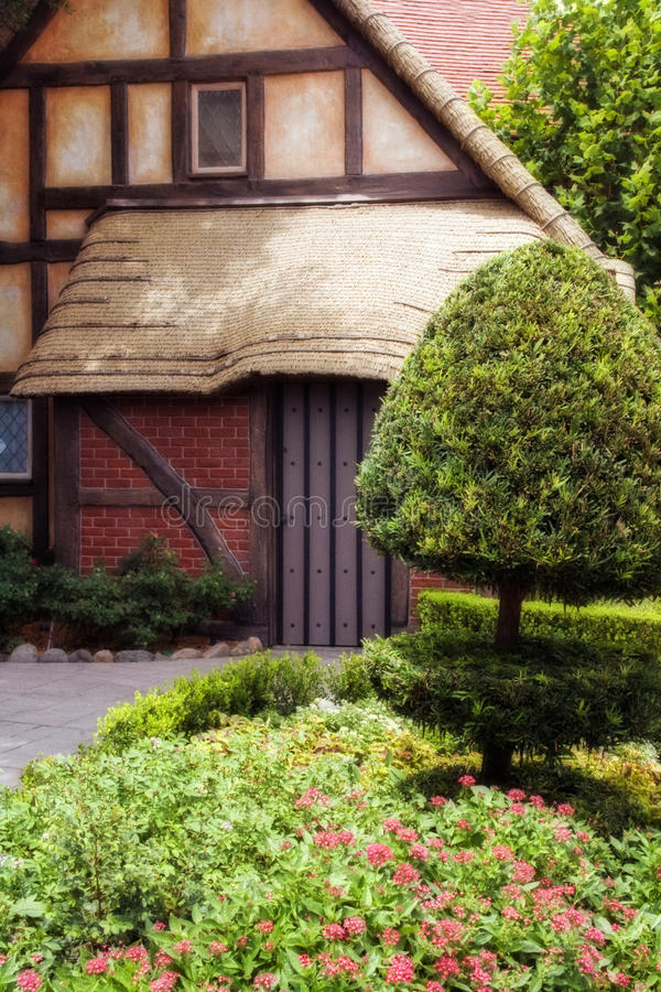 Front View of House. Face on of the thatch housing with gardens in front royalty free stock images