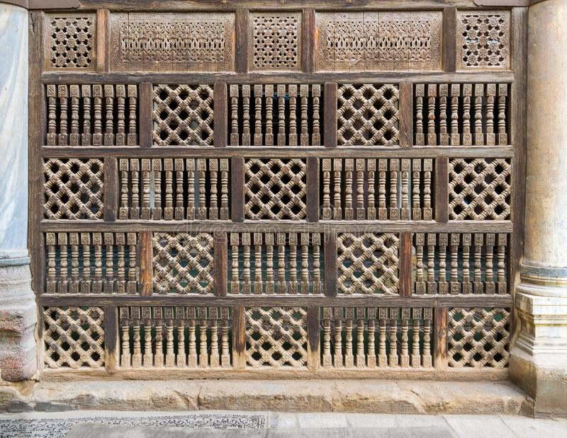 Front view of interleaved wooden arabisk wall - Mashrabiya, Cairo, Egypt. Front view of interleaved wooden arabisk wall - Mashrabiya, Facade of public historic stock photo