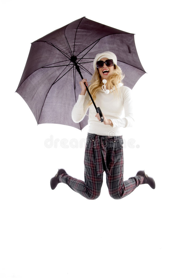 Front view of jumping woman holding an umbrella royalty free stock photos