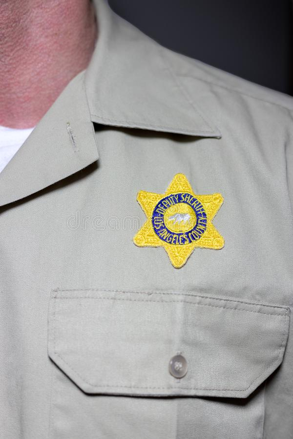 front view of LASD uniform showing cloth badge and partial shoulder patch royalty free stock photography