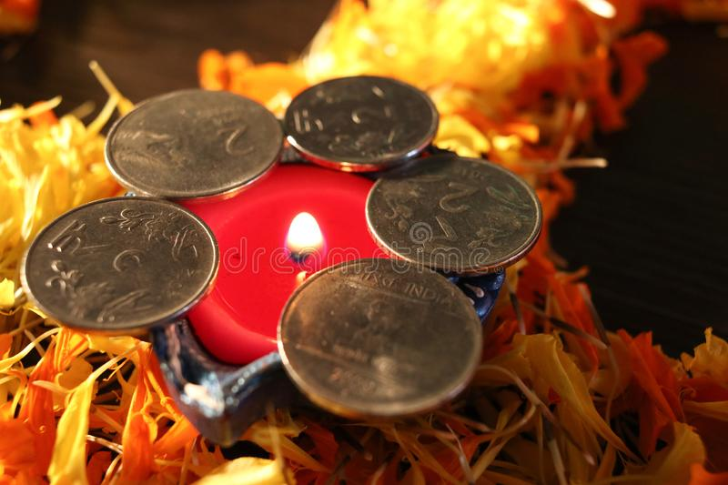 Dhanteras and diwali background.diwali greetings and wishes. A front view of lit Diya/lamp placed on flowers to celebrate dhanteras and diwali festival royalty free stock photo