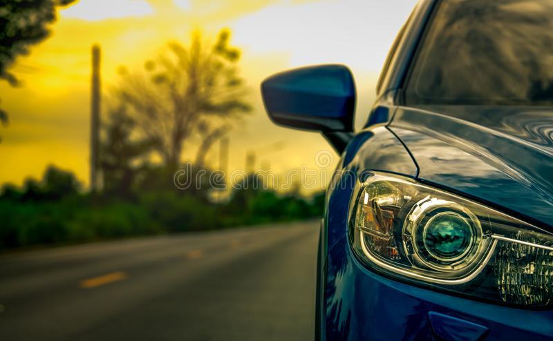 Front view of luxury blue compact SUV car with sport and modern design parked on asphalt road at sunset. Hybrid auto royalty free stock photography