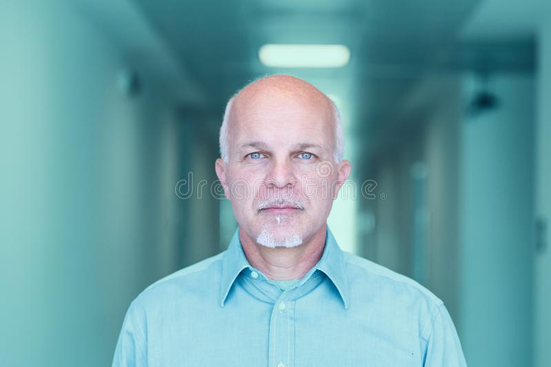 Front view of mature man looking stoic. Front view of Business man looking stoic and facing the camera royalty free stock photos