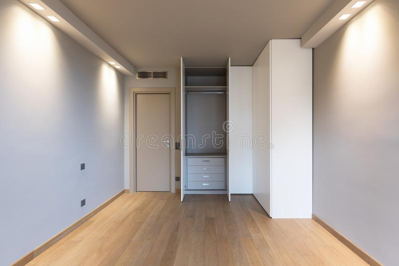 Front view of modern room with large wardrobe royalty free stock photos