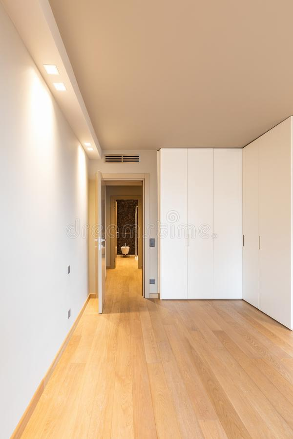 Front view of modern room with large wardrobe stock photography