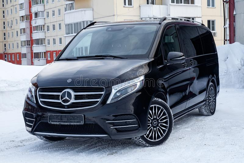 Front view of new a expensive Mercedes Benz V-class minivan bumper and hood of a car, a long black limousine, model outdoors,. Novosibirsk, Russia - 08.01.2018 royalty free stock photo