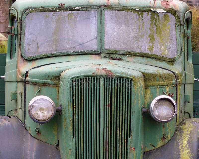 Front view of an old abandoned green rusty 1940s truck stock images