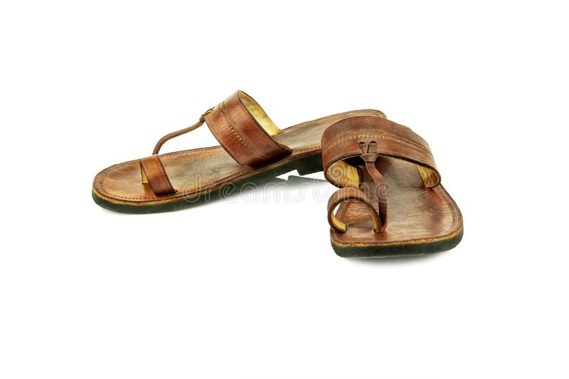 Front view of a pair of brown traditional indian leather sandals isolated on white background. royalty free stock photos