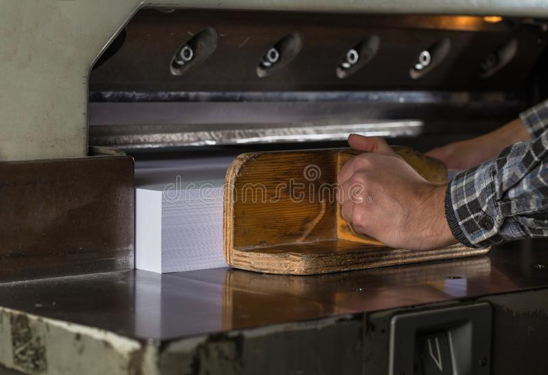 Front view of a paper guillotine in commercial printing industry. Hydraulic industrial guillotine. Selective focus royalty free stock images