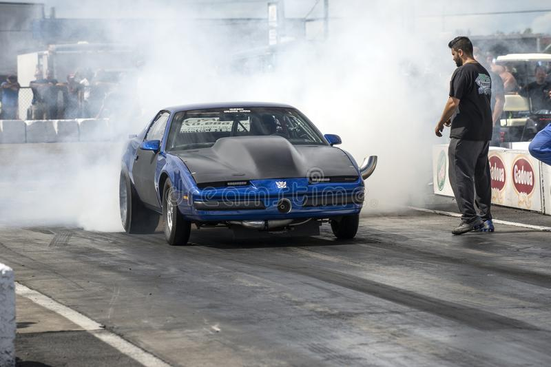 Firebird smoke show. Front view of pontiac firebird on the track making a smoke show during the john scotti all out august 17, 2017 stock image