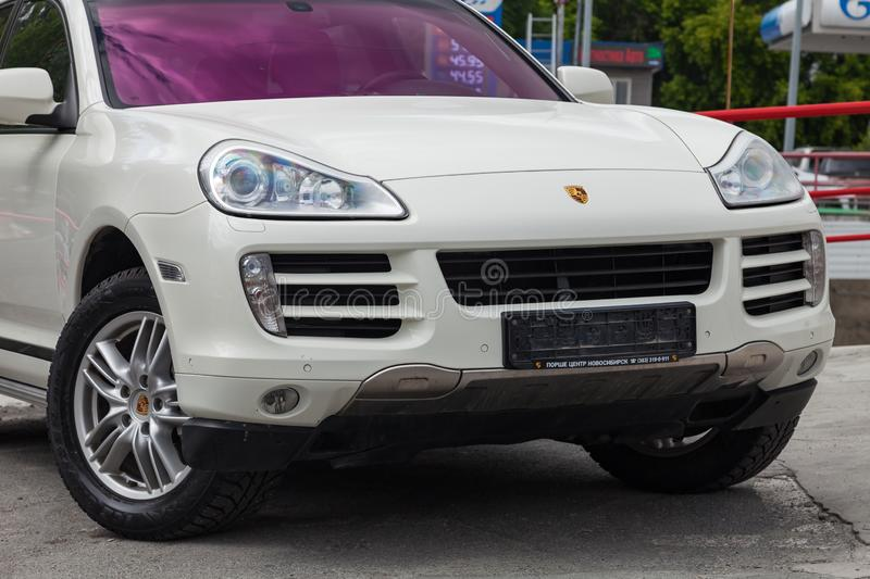 Front view of Porsche Cayenne 957 2007 in white color after cleaning before sale in a summer day on parking stock photos