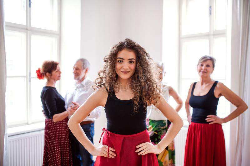 Portrait of dance teacher with group of seniors in dancing class. royalty free stock photos