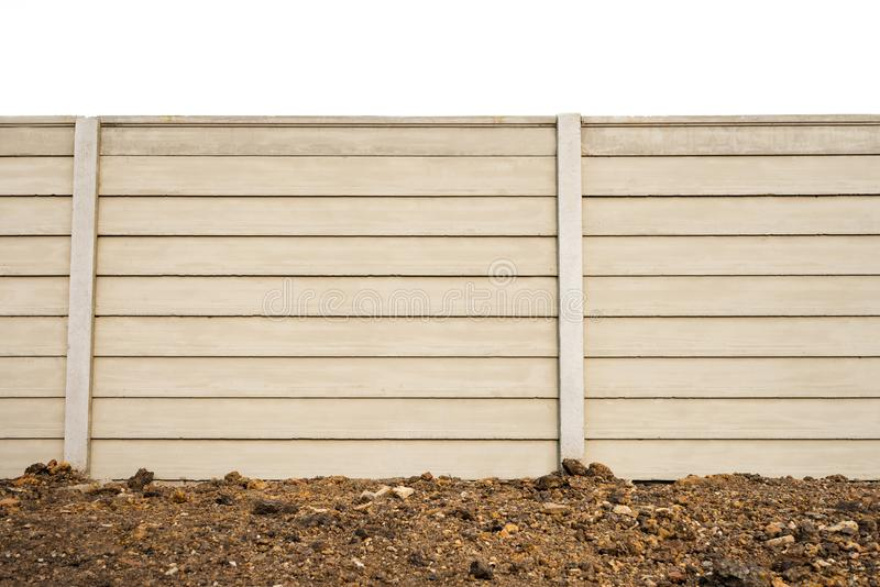 Front view of precast concrete Wall on fresh ground floor, prefabricated cement compound wall isolated on white background royalty free stock images
