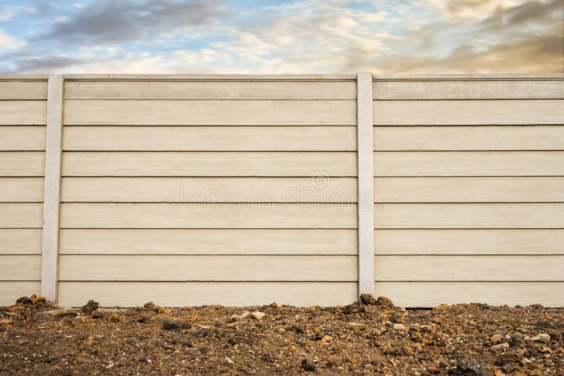 Front view of precast concrete Wall on fresh ground floor, prefabricated cement compound wall over cloudy sky royalty free stock photography