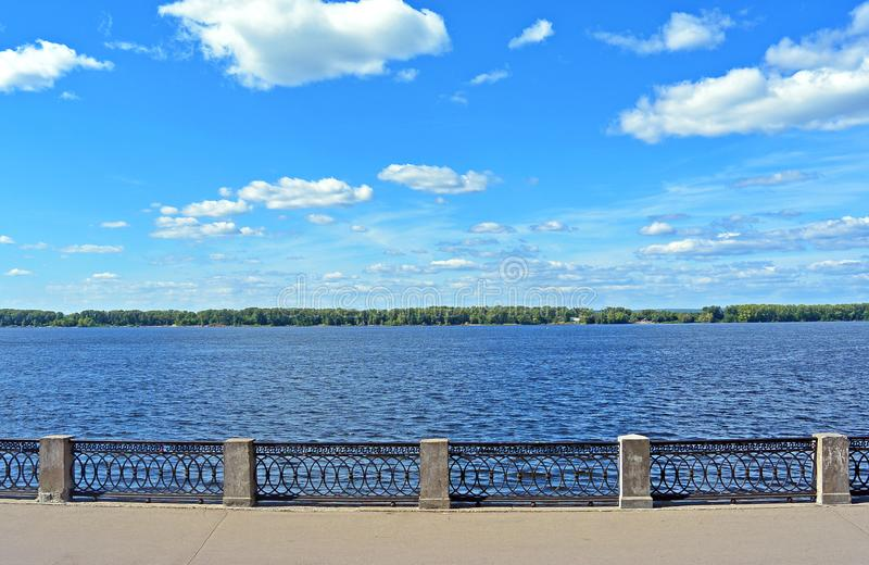 Front view on quay of river Volga in Samara city, Russia on sunny summer day. Front view on quay of river Volga in Samara city, Russia. Embankment promenade on royalty free stock photos