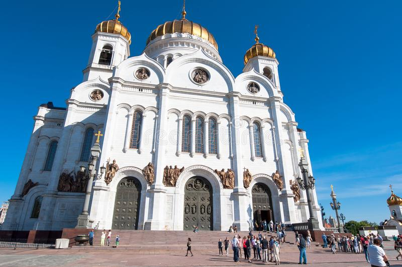Front view of the rebuilt Cathedral of Christ the Saviour during the midday, locals and tourists go sightseeing. Moscow, Russia-May 27, 2018: Front view of the royalty free stock photos