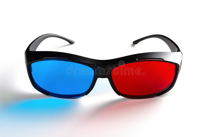 Front view of a red and blue 3D glasses on white stock images