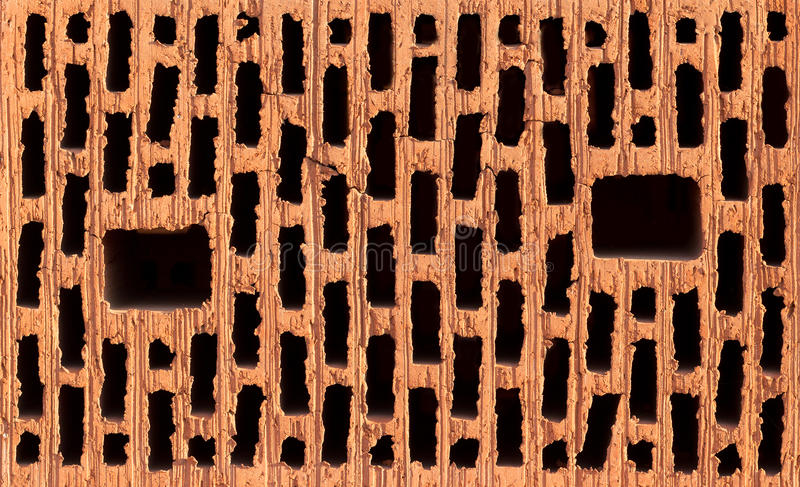 Download Front View Of Red Brick With Black Holes Stock Photo