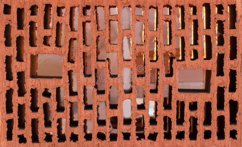 Download Front View Of Red Brick With Holes Stock Photo