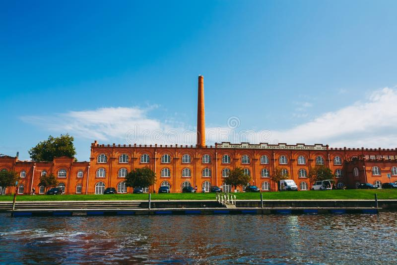 Front view on the red brick old ceramics factory on the Cojo Canal in Aveiro. Fabric of Jernymo Pereira Campos with tall chimney. stock photography
