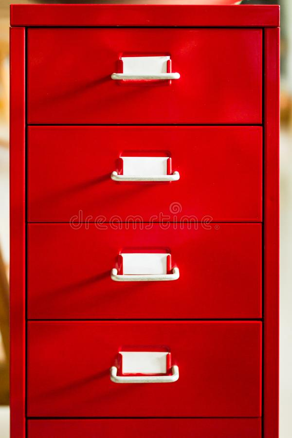 The front view of the red document drawer is closed and is label stock photo