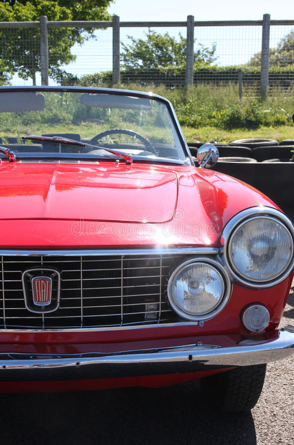 Front view of red Fiat 124 sport vintage motorcar. Front grille, bonnet/hood and windscreen royalty free stock image