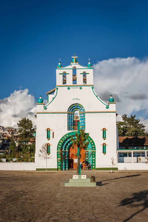 San Bautista church in San Juan Chamula market, Chiapas, Mexico. Front view of the San Bautista church in San Juan Chamula market, Chiapas, Mexico royalty free stock image