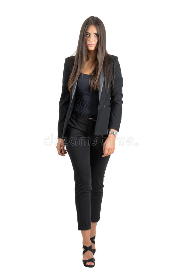 Front view of serious tough woman walking towards camera with intense look stock images