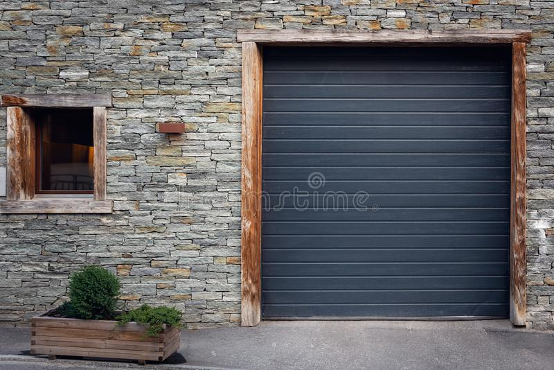 Front View of Shutter Door and Window With Tile Stone Background, Antique Architecture of Entrance Private Door stock photo