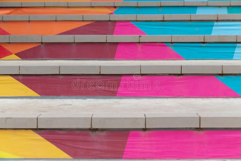 Front view of Stair with steps painted in abstract colorful. stock photo