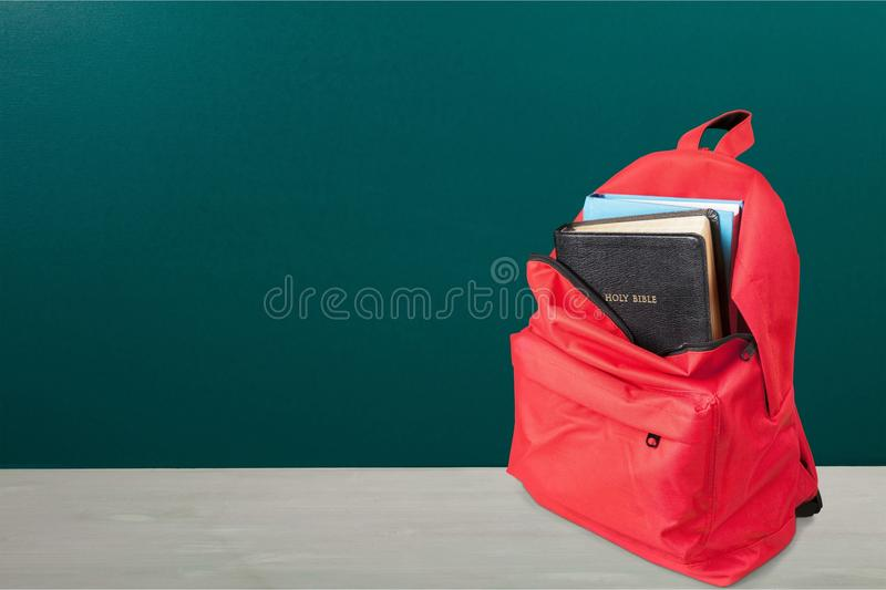 Holy Bible book in School Backpack royalty free stock photo