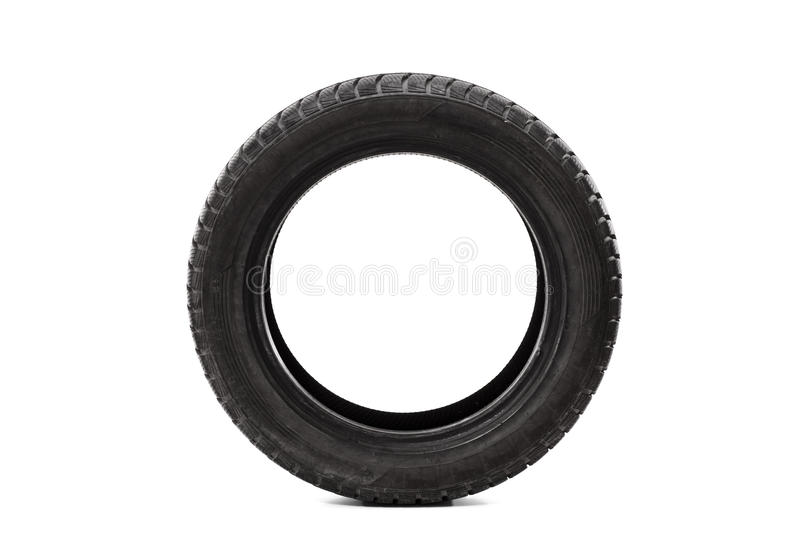 Front view studio shot of a single car tire. Isolated on white background royalty free stock photography