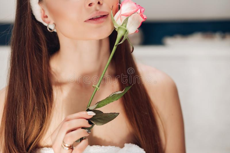 Front view of tender woman after shower caring about skin. Front view of beautiful tender woman after shower caring about skin in morning. Young long haired lady stock photography