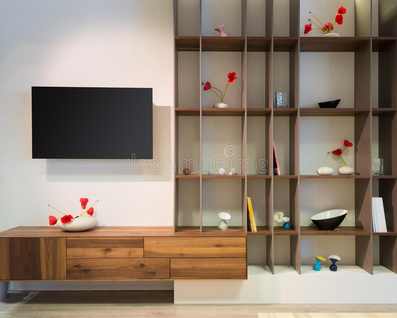 Front view to living room wall withh wooden shelf. And flat tv royalty free stock images