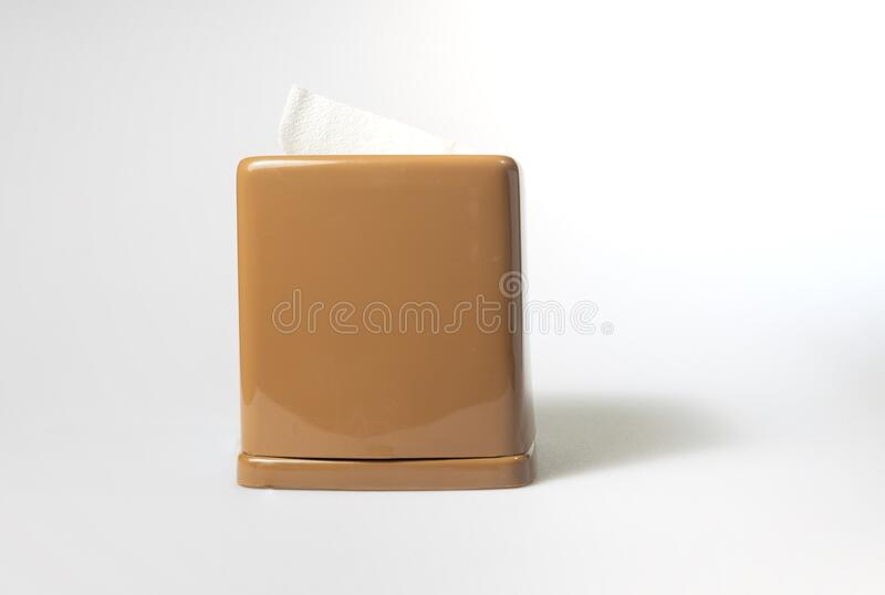 front view of the toilet paper or tissue in brown rectangular napkin box on white background stock image