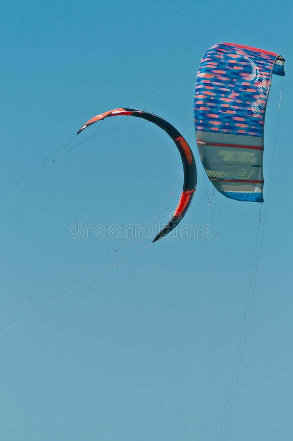 Front view of two colorful canopy of a kiteboard filled with wind stock photo