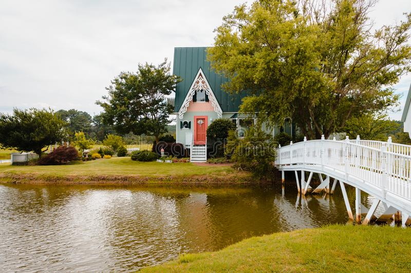 Front view of a Victorian cottage on a pond island in Virginia royalty free stock photography