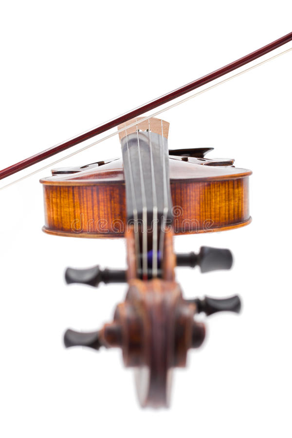 Front view of a violin with bow on strings royalty free stock photography