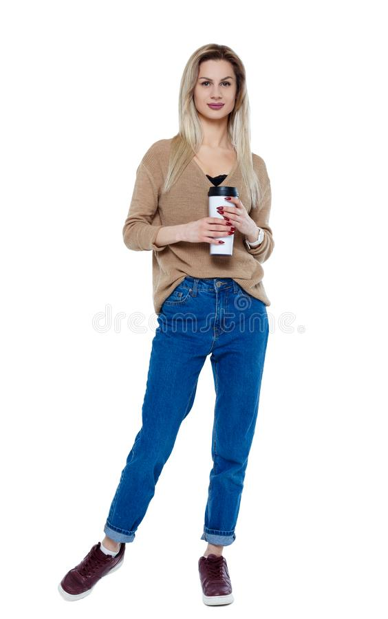 Front view of walking  woman  with coffee cup stock photo