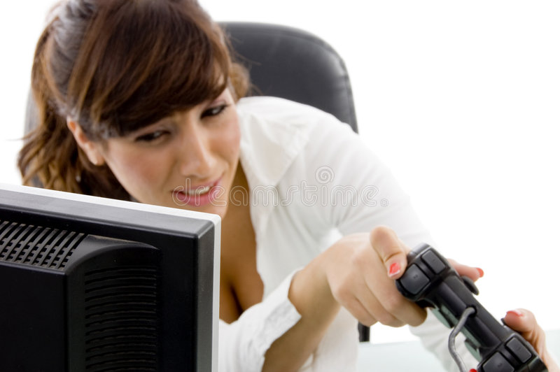 Front view of woman executive playing videogame. Front view of woman executive playing video game with white background stock photography