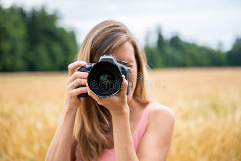 Woman making photos royalty free stock photography