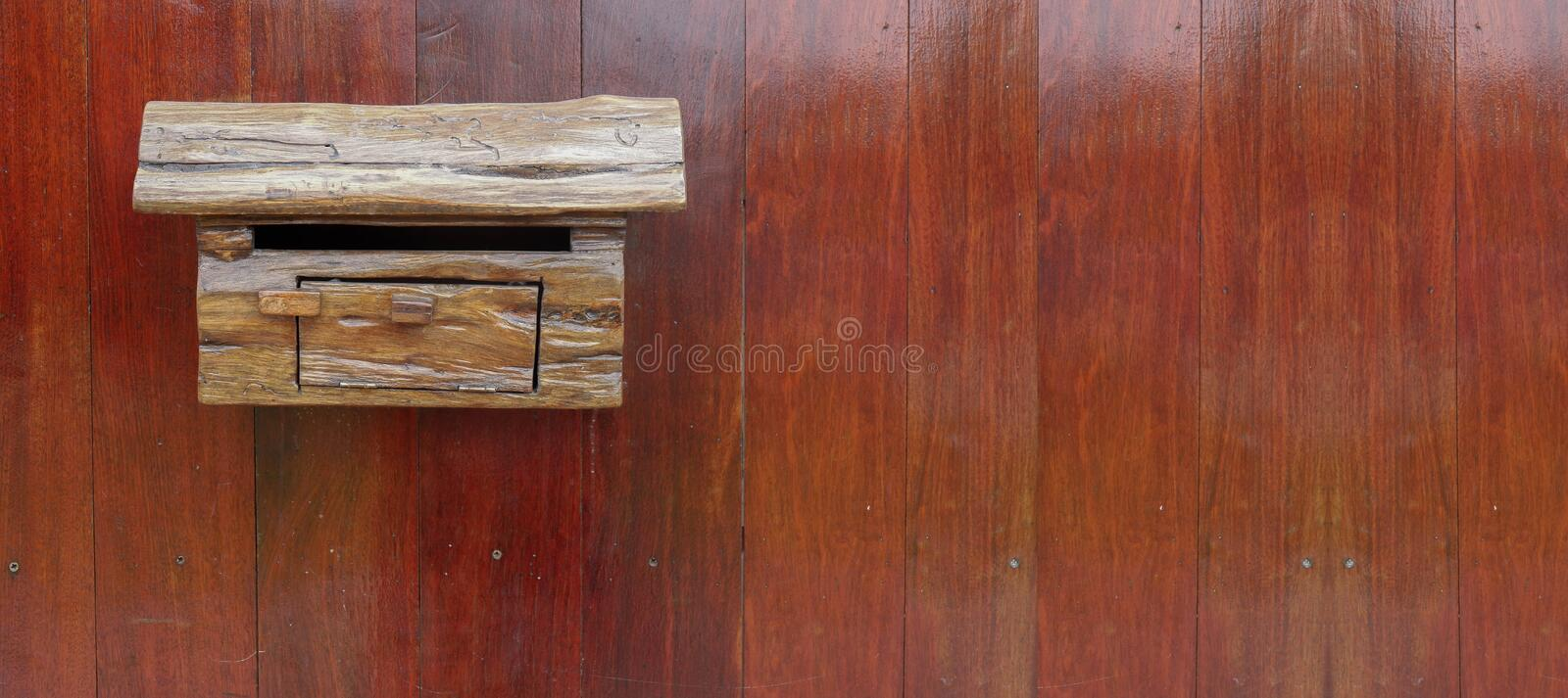 Front view wooden mailbox on wooden wall background,copy space stock images
