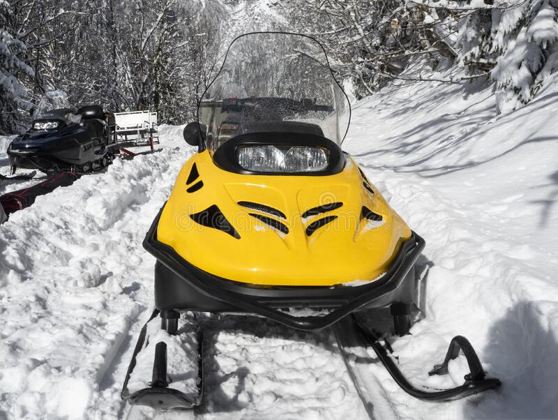 Front view of yellow snowmobiles stock image