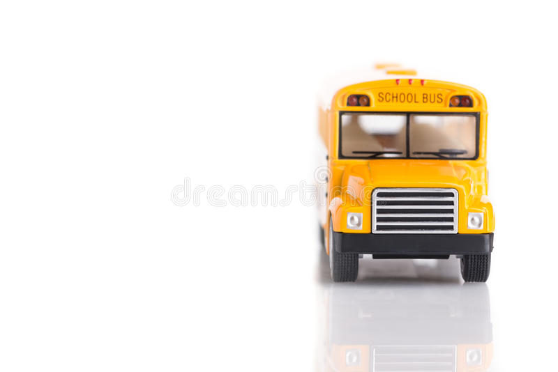 Front view of yellow school bus toy made from plastic and metal royalty free stock images